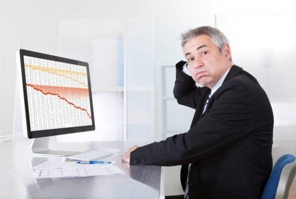 confused man sitting at computer