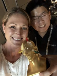 Upskill employees Christine and Jay posing backstage with our Auggie Award!